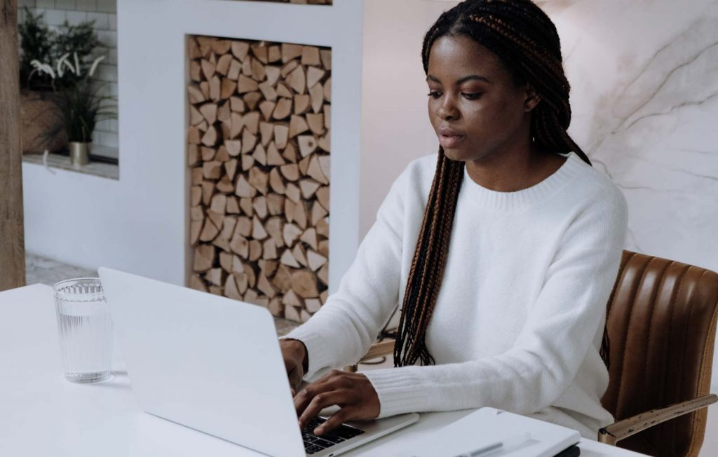 Woman Using Laptop - Best Airbnb Pricing Tools